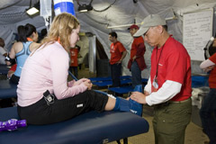 A runner is examined inside the DRASH medical surge facility.