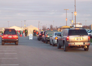 Cars line up in front of the DRASH H1N1 drive-thru vaccination clinic in Madison County, IN.