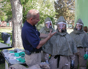 Ret. Army Medic Ken Hall trains hospital personnel during a decon demonstration in Boise, Idaho.