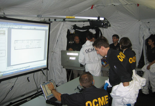 NYC OCME personnel respond inside a DRASH mobile command shelter during an August 25th multi-agency exercise at Penn Station.